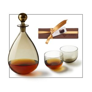 Glass whiskey decanter and glasses with caramels