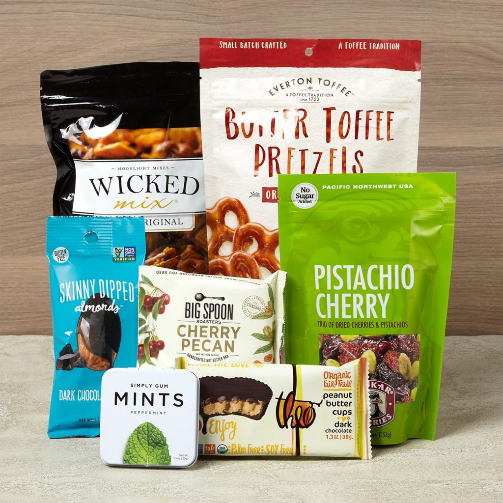 Gift set with nut butter bar, fruit and nut mix, all-natural peppermints, toffee pretzels, peanut butter cups, cocoa covered almonds and pretzel snack mix