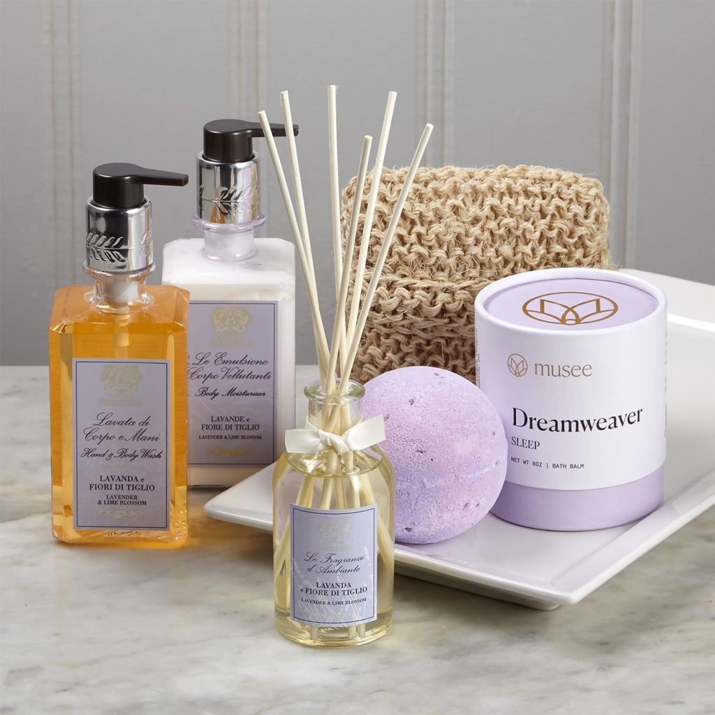 """Antica Farmacista Lavender & Lime Blossom Hand and Body Wash 10 oz, Antica Farmacista Lavender & Lime Blossom Moisturizer, 10 oz, Antica Farmacista Room Diffuser 100 ml glass fragrance bottle and 7 diffuser reeds, Baudelaire Sisal Body Scrubber 4"""" w x 5"""" h x 1.5"""" d musee Dreamweaver Bath Balm 8 oz"""