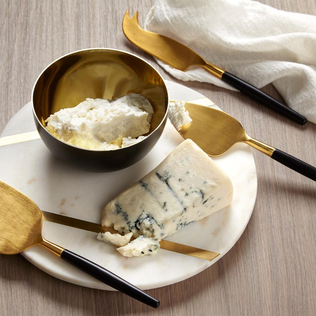 Gift set with marble cutting board and brass utensils and bowl