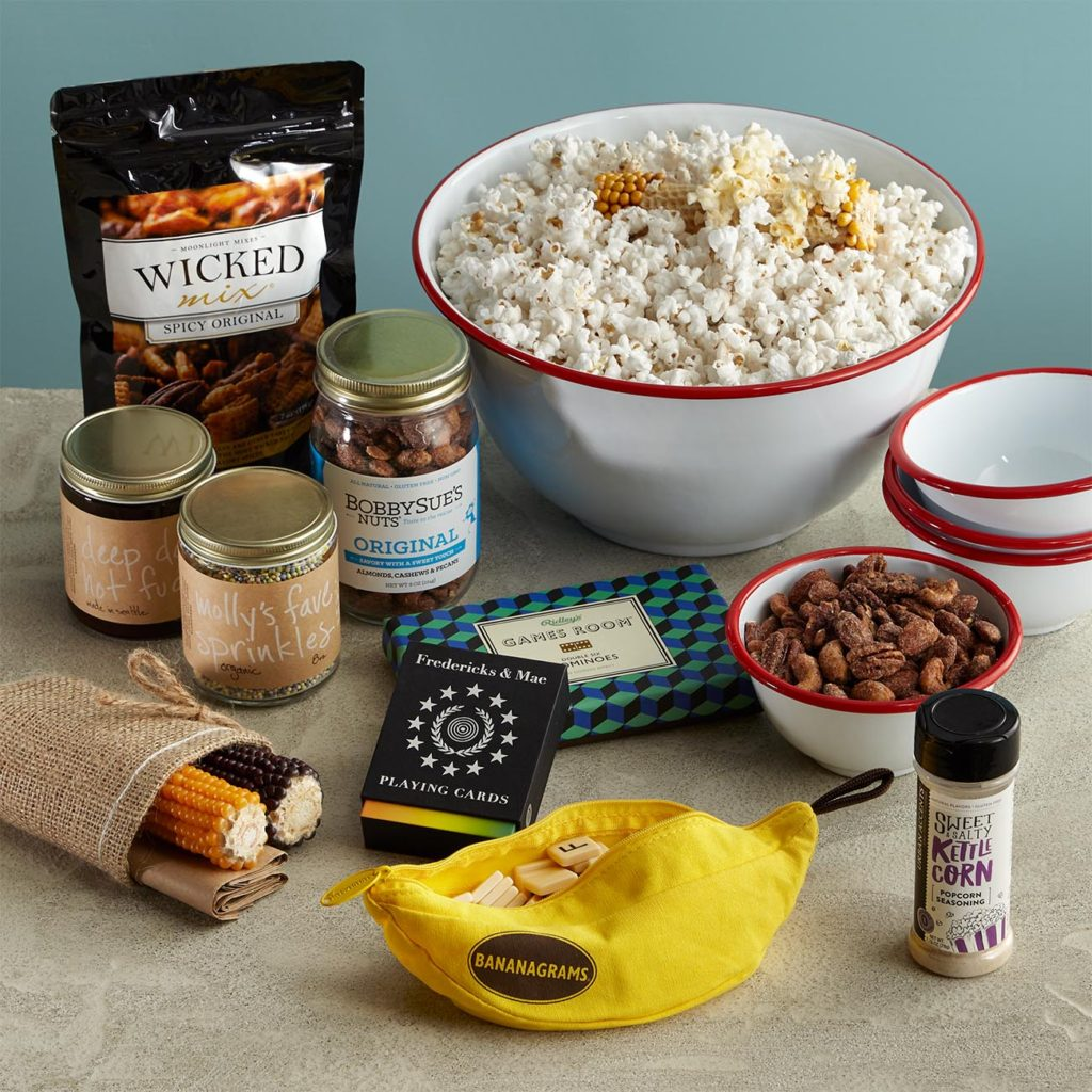 Popcorn bowls, popcorn, popcorn seasoning, snack mix, ice cream toppings, assorted nuts, and three games