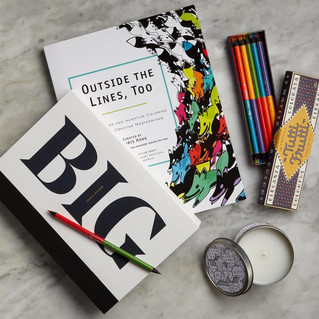Gift set with premium notebook, adult coloring book, colored pencils, and a scented candle