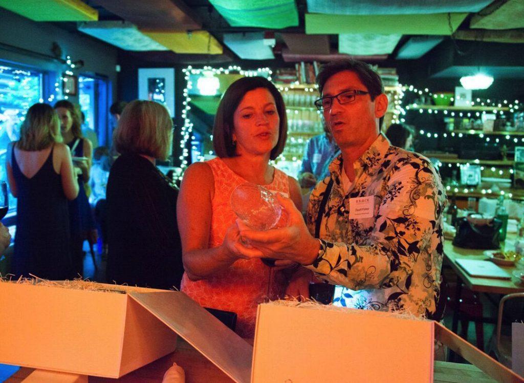 Knack wine launch party guests admiring handblown glassware