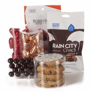 A chocolate lover's care package with chocolate, Rain City Crunch granola, BobbySue's Nuts, milk chocolate hearts
