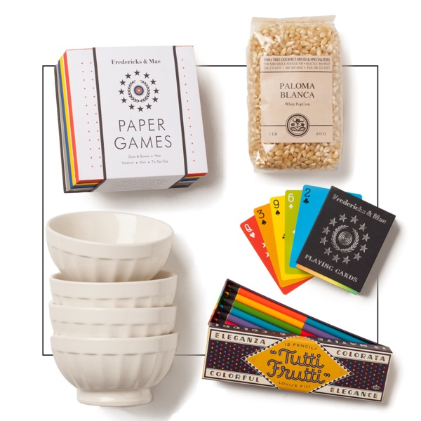 Family Game Night gift with paper games, ceramic bowls, popcorn, cards and colored pencils