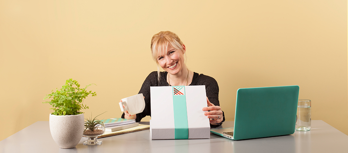 Photo of a female admin receiving an Administrative Professionals Day gift
