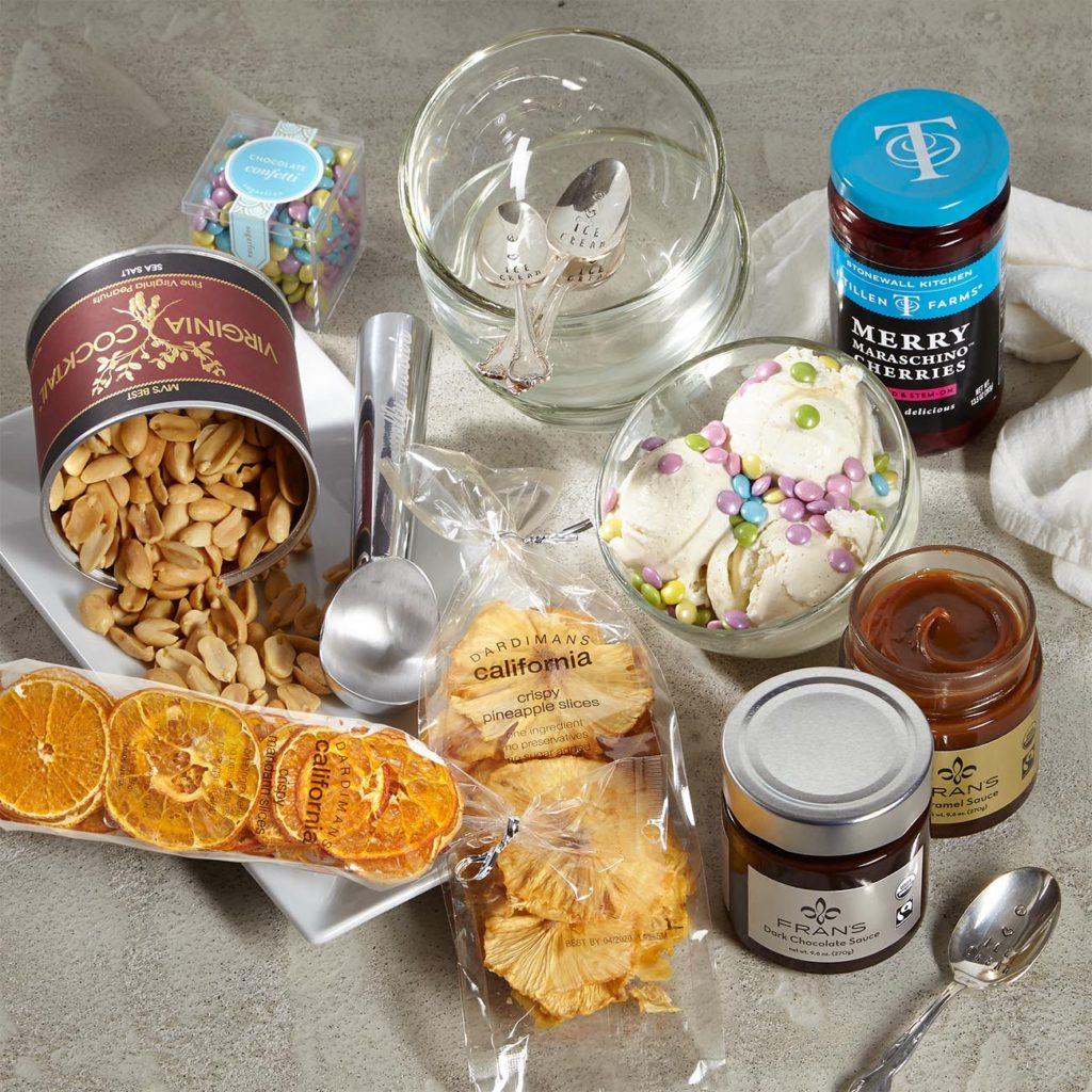 "4 La Rochere Bubble Glass Bowls 4.75"" d each, 4 Paka Monk ""Peace, Love & Ice Cream"" handstamped spoons, Molly Moon's Ice Cream Scoop 7.25"" h, Fran's Chocolates Caramel Sauce 9.6 oz, Fran's Chocolates Dark Chocolate Sauce 9.6 oz, Sugarfina Chocolate Confetti approx. 138 pieces, Dardimans California Mandarin Crispy Fruit Slices 2.0 oz, Dardimans California Crispy Fruit Slices Pineapple 1.7 oz, Virginia Cocktail Sea Salt Peanuts 10 oz tin, Stonewall Kitchen Merry Maraschino Cherries 13.5 oz"
