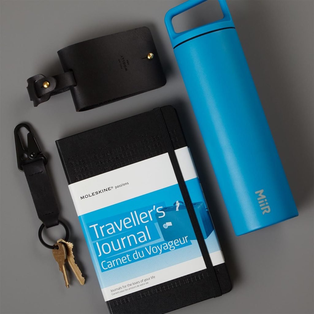 """Moleskine Traveller's Journal, 240 pages with 202 adhesive stickers 5"""" w x 8.25"""" h, MiiR vacuum-insulated wide mouth bottle 16 oz, 8.75"""" tall with lid, WOOLLY Clip Leather Keychain 5.5"""" long (including keyring and clip), WOOLLY Black Leather Luggage Tag 2.75"""" w x 4"""" h (closed, excluding strap)"""