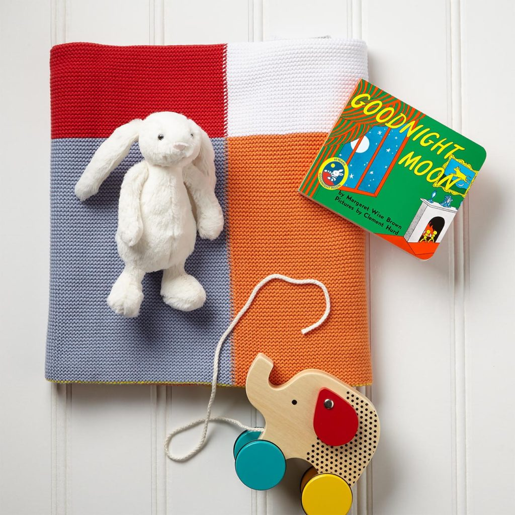 "Elegant Baby Bright Patchwork Blanket, 30"" w  x 40"" h, Petit Collage Jumping Jumbo Elephant Pull Toy, 5.25"" h x 6.5"" w, Goodnight Moon by Margaret Wise Brown and Clement Hurd, board book, 6"" w x 5"" h, Jellycat Bashful Bunny Soft Plush Toy, 7"" h"