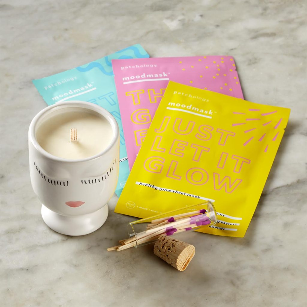 Gift set with 3 sheet facial masks and a candle with a pretty stylized face
