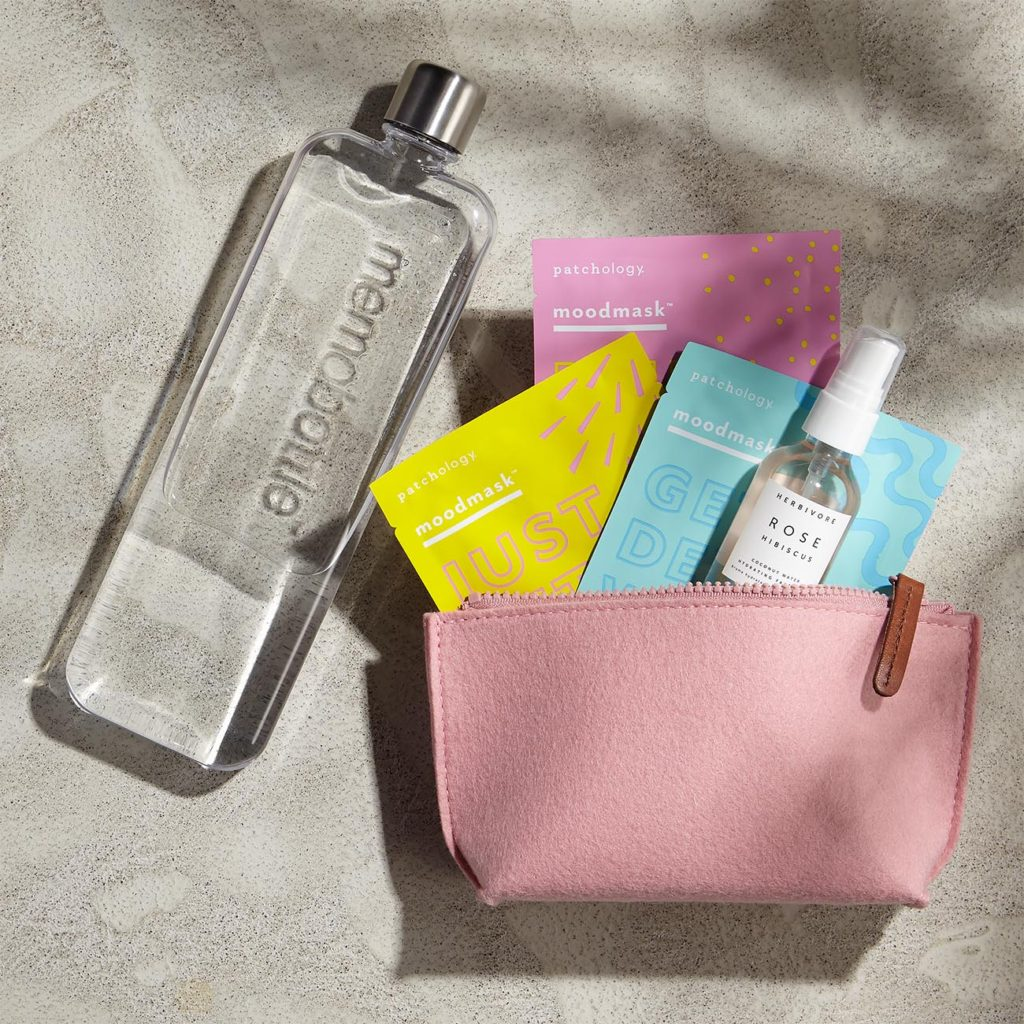 Slim water bottle, rose face mist, three sheet facial masks, blush-colored zippered bag