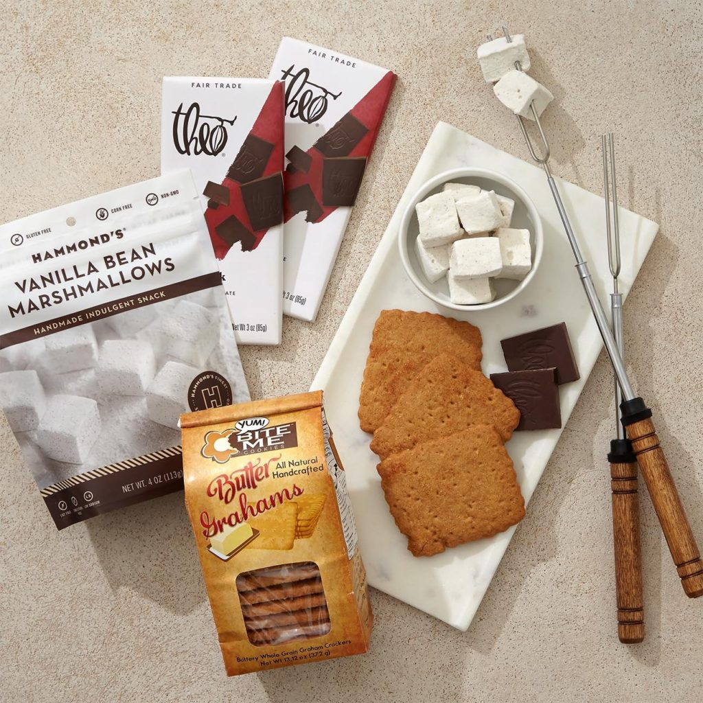 contains crisp graham crackers, dark chocolate, and tender marshmallows ready to be roasted. Makes a perfect family gift for a client.
