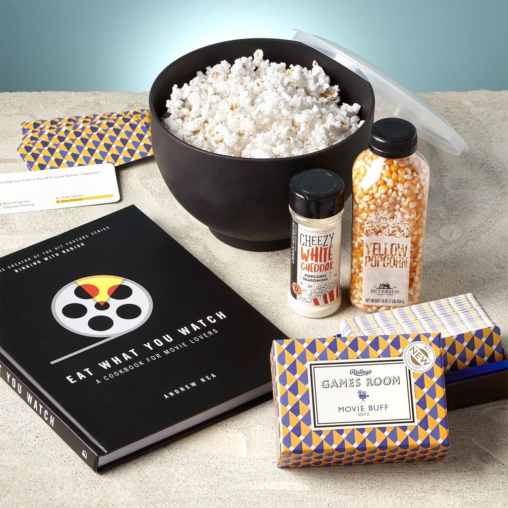 Eat What You Watch: A Cookbook for Movie Lovers, 40 recipes W & P Design The Popper, 74.4 oz capacity Petersen Family Farm Yellow Popcorn, 16 oz bottle Urban Accents White Cheddar Popcorn Seasoning, 2.25 oz Ridley's Movie Buff Game, 140 Question Cards