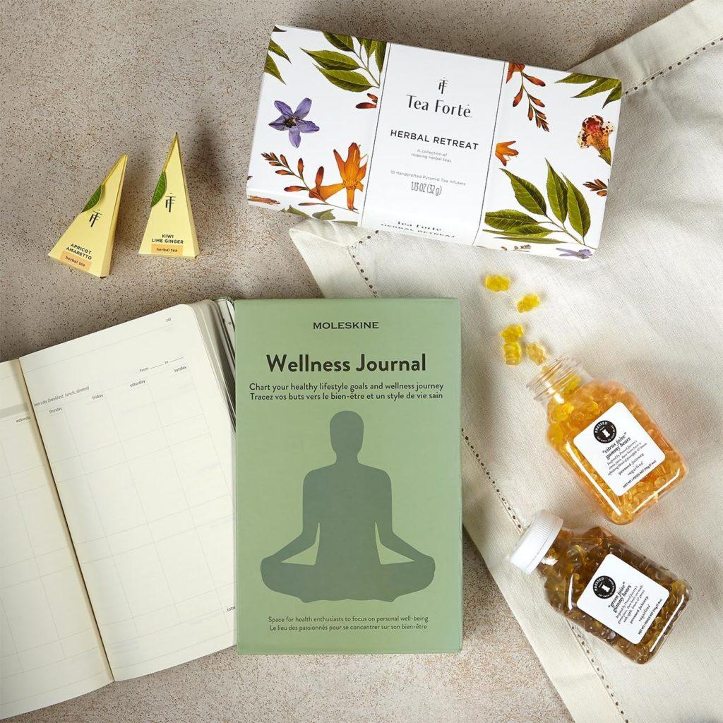 mindfulness journal, tea, and gummie candies