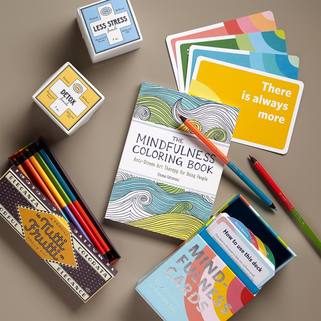Colored pencils, coloring book, and fizzing bath cubes, and mindfulness cards